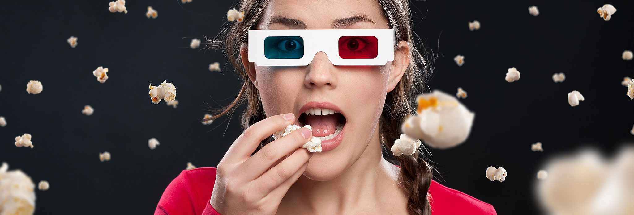 3DMoviegoer Woman Eating Popcorn
