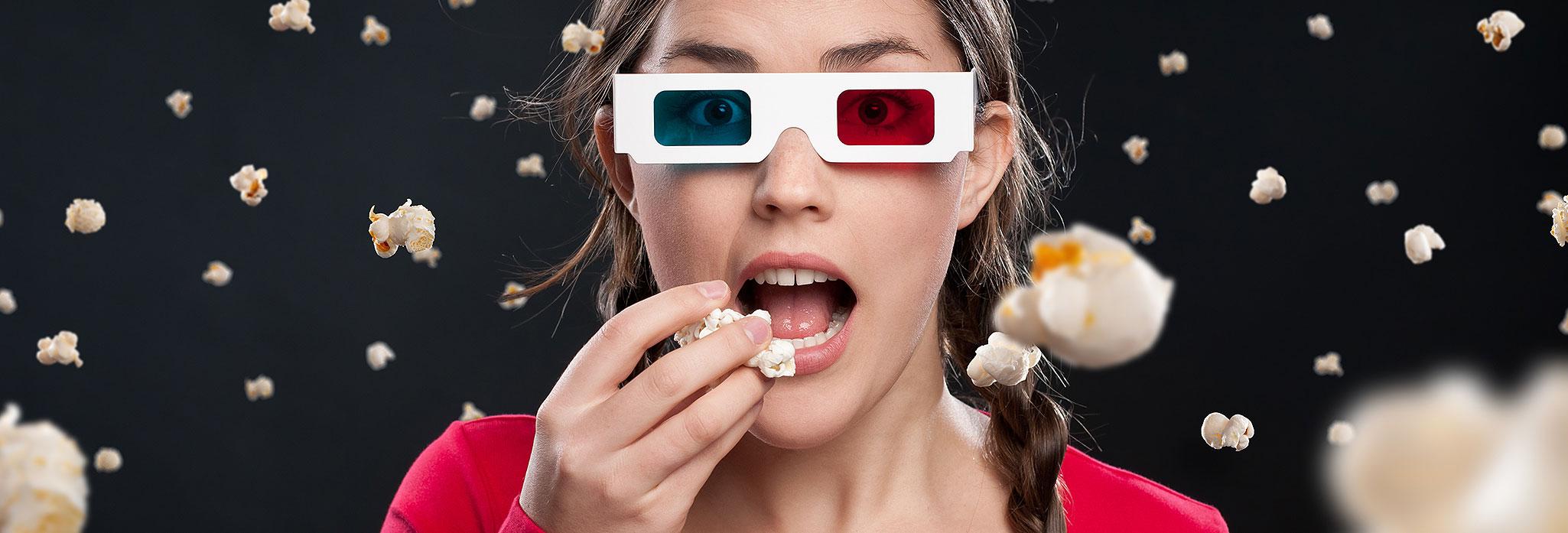 3DMoviegoer Woman Eating Popcorn